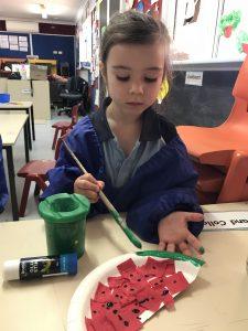 Mia making watermelon